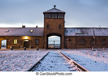 Main gate to concentration camp of Auschwitz Birkenau,...