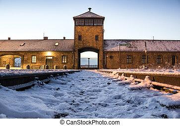 Main gate to concentration camp of Auschwitz Birkenau,...