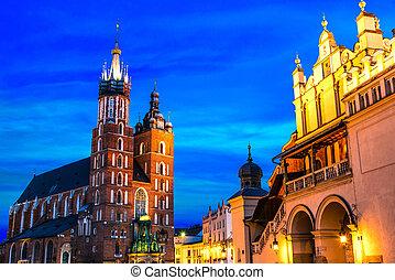 Main Market Square with Saint Mary's Basilica in Krakow, Poland