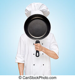 Main menu. - Restaurant chef hiding behind a frying pan for...