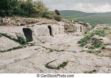 Main road in ancient stone town-fortess Eski-Kermen high in a rocky mountains. Bakhchysarai, Crimea.