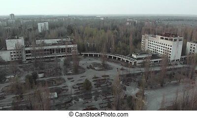 Main square of the abandoned city Pripyat. Drone flies over...
