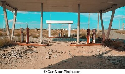 main street of america. Route 66. crisis road 66 fueling broken window slow motion video. Old dirty deserted gas station. U.S. closed supermarket store shop Abandoned gas station oil end of fuel the world apocalypse petrol. mother of the roads. lifestyle mother of the roads