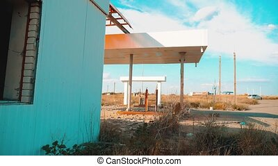 main street of america. Route 66. crisis road 66 fueling slow motion video. Old dirty deserted gas station. U.S. closed supermarket store shop Abandoned gas station oil end of fuel the world apocalypse petrol. mother of the roads. mother of lifestyle the roads