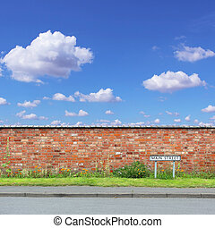 Main Street - Red Brick Wall with a Main Street Sign and...