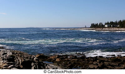 Maine Coastline Surf - Waves roll in on the rocky coast of...