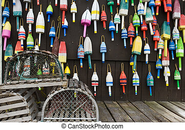 Maine landscape - Lobster traps and colorful buoys on...