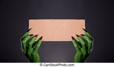 mains, tenue, noir, vide, carte, monstre, morceau, vert, clous
