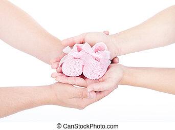 mains, tenue, sur, nouveau-né, mère, white., main., père, booties., main, rose