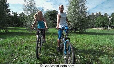 Maintaining Balance - Cyclists trying to keep balance on...