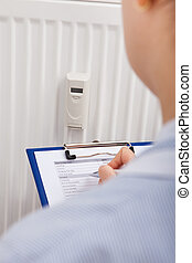 Maintaining Records Of Digital Thermostat On Clipboard -...