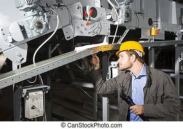 Maintenance engineer at work - A maintenance engineer at ...