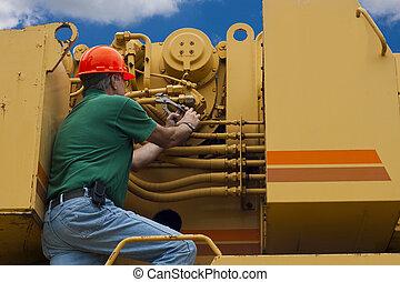 maintenance mechanic - man doing maintenance work on a large...