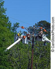 Maintenance on Utility Lines - Three linemen perform...