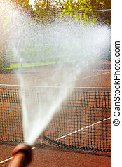 maintenance sprinkler tennis court