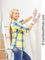 maison, femme souriante, gants, rénovations