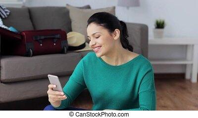 maison, voyage, smartphone, remplir, femme