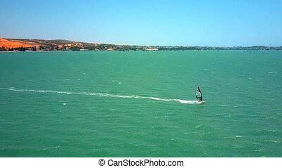 windsurfer beginner makes turn on open ocean - majestic...