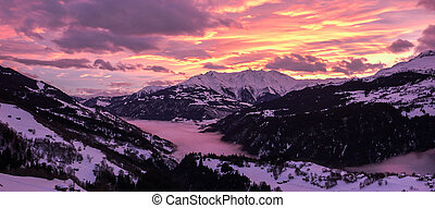 majestic and colorful sunset over a winter mountain landscape in the Alps