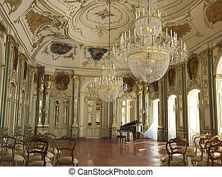 Majestic large decorated piano concert hall. With golden...
