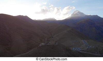 Majestic Mount Kazbek and Holy Trinity Church in Georgian ...
