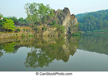 Majestic mountain cliff with reflection