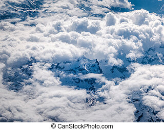 Majestic mountains peak in Alps seen from the high flying...