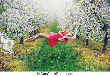 Majestic slim nymph levitating in the orchard - Majestic...