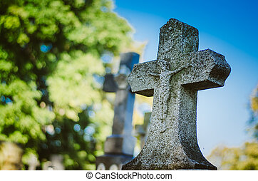 majestic stone cross in the cemetery