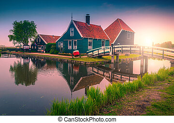 Majestic touristic village with traditional houses at sunrise, Zaanse Schans