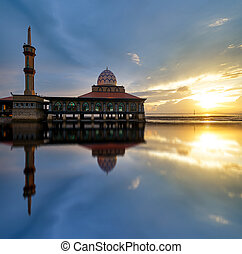 Majestic view of Al-Hussain Mosque in Perlis, Malaysua will full reflection during sunset.
