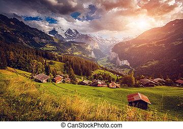 Majestic view of alpine village. Location Swiss alps, Lauterbrunnen valley, Wengen, Europe.