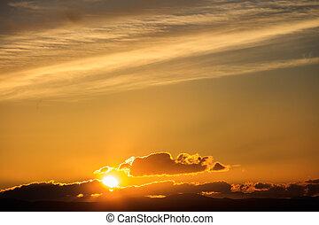 Majestic vivid sunset over dark mountains