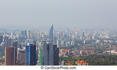 Overlooking shot of a major, metropolitan city with beautiful and contemporary highrise architecture on a hazy day.