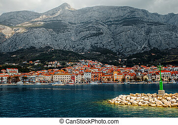 Makarska city. View from the sea with light house on ...