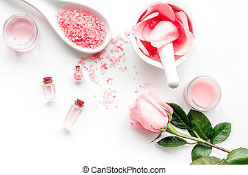 Make cosmetics with rose oil. Mortar with rose petals and...