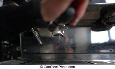 make espresso with a coffee machine.