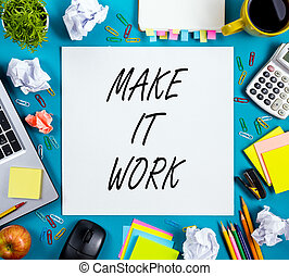 Make it work. Office table desk with supplies, note pad, cup, pen, pc, crumpled paper, flower on blue background. Top view