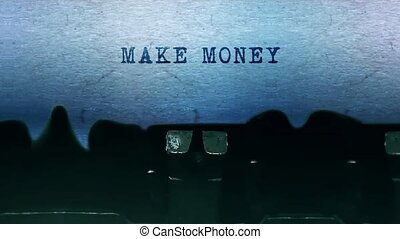 Make Money words Typing on a sheet of paper with an old vintage typewriter.