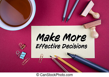 Make More Effective Decisions. Red background with office supplies