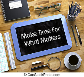Make Time For What Matters Handwritten on Small Chalkboard. 3D.