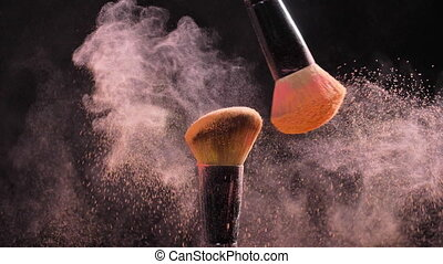 Make-up and beauty concept. Brush with pink powder explosion...