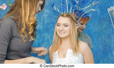 Make-up artist and stylist make the image of the elven princess.