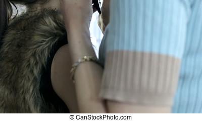 Make-up artist applying eyeshadows to model