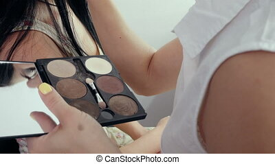 Make-up artist applying makeup