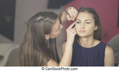 Make up artist applying toning cream to a model s face