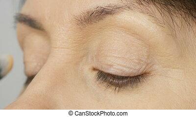 Make up artist do makeup with highlighter concealer to...