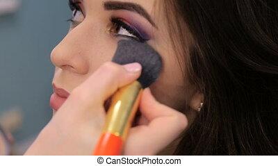 Make-up artist doing make-up, face close-up