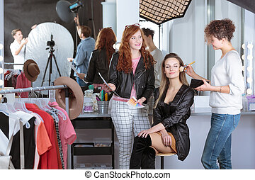 Make-up artist preparing model - Make-up artist preparing...
