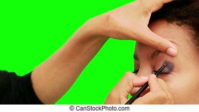 Make up artist putting eye shadow